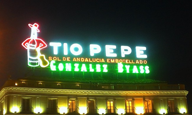 The neon sign TÍO PEPE again illuminates the Puerta del Sol